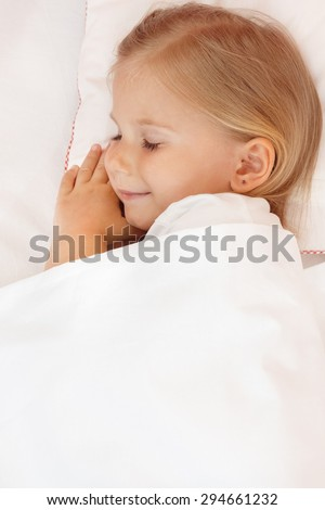 Adorable little girl sleeping in the bed. - stock photo