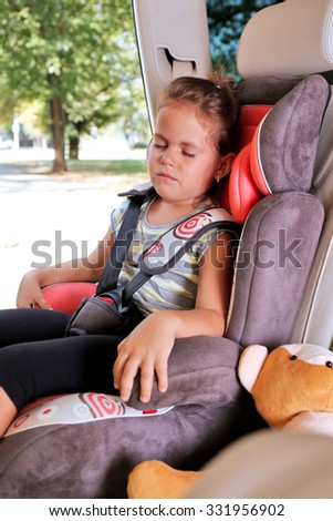 Adorable little girl sleeping in the car - stock photo