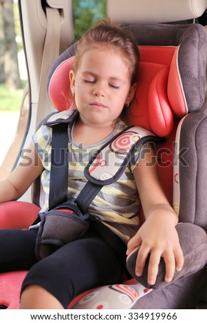 Adorable little girl sleeping in the car
