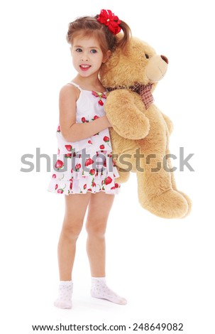 Adorable little girl teddy bear in hand .Isolated on white background, Lotus Children's Center - stock photo