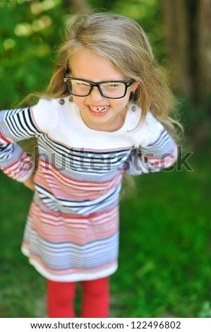 Adorable little girl wearing glasses - stock photo