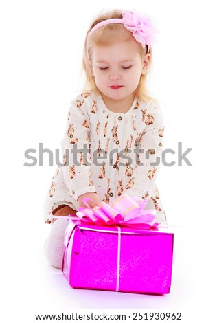 Adorable little girl with a bow on her head open with a gift box .Isolated on white background, Lotus Children's Center. - stock photo