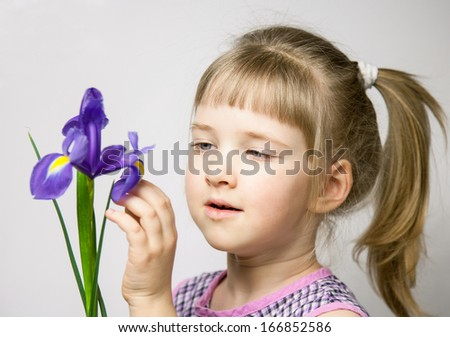 Adorable little girl with beautiful iris, neutral background - stock photo