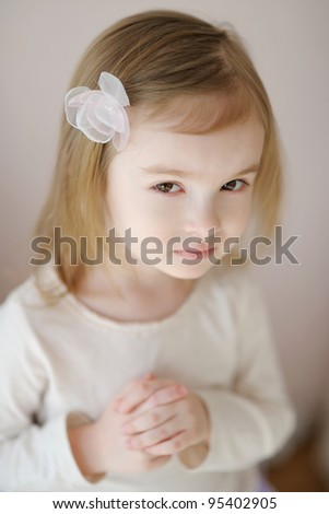 Adorable little girl with flower hairclip - stock photo