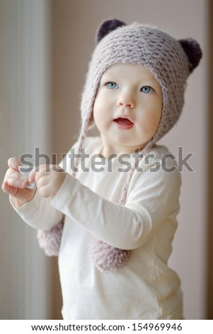 Adorable little girl with funny kitty hat - stock photo