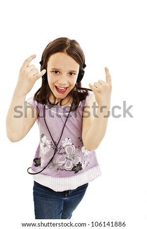 Adorable little girl with headphones. Isolated on a white background - stock photo