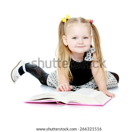 Adorable little girl with pigtails reading a book.- isolated on white background - stock photo