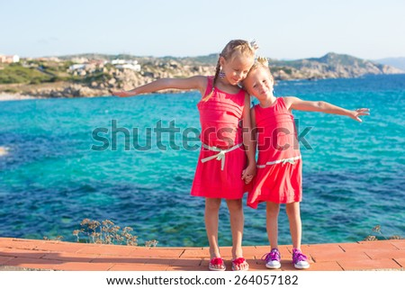 Adorable little girls at tropical beach during summer vacation - stock photo