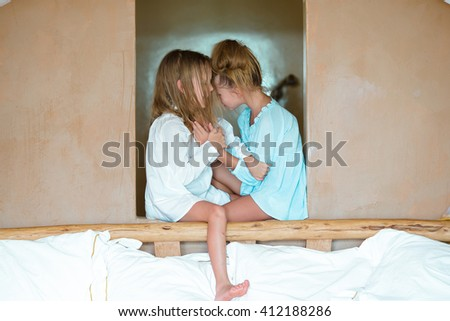 Adorable little girls having fun at home - stock photo