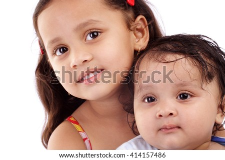 Adorable little Indian sisters isolated on white background