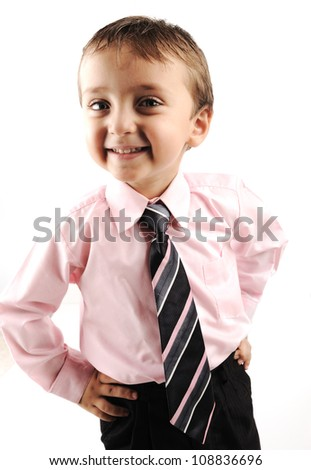 Adorable little kid wearing a suite - stock photo
