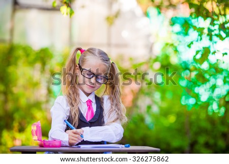 Adorable little school girl outdoor. Back to school. - stock photo