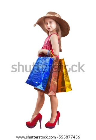 Adorable little shopper in a big hat with a gift bag high heels