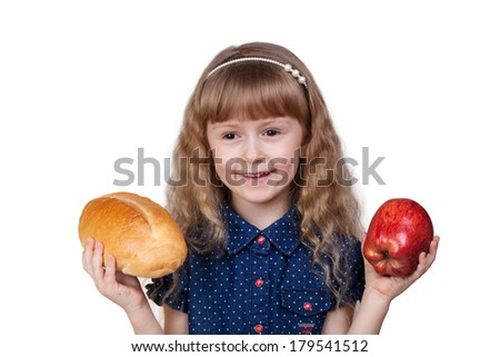 Adorable little smiling girl with red apple and bread isolated on white background - stock photo