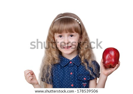 Adorable little smiling girl with red apple isolated on white background