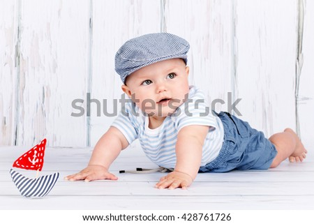 Adorable little toddler playing to be a sailor - stock photo