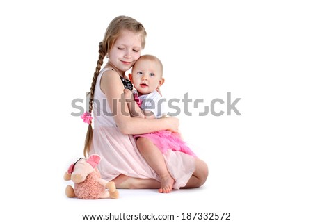 adorable little two sisters 8 year and  11 month old on white background - stock photo