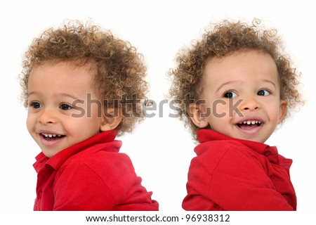 Adorable-looking twins with curly hair - stock photo