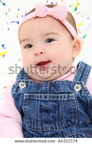 Adorable 4 month old baby girl close up smiling.