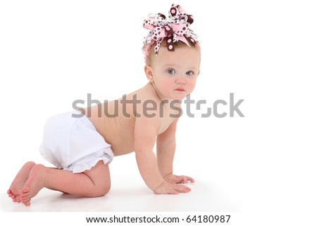 Adorable 10 month old baby girl crawling over white background. - stock photo