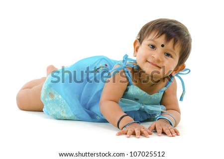 Adorable 10 months old Indian baby girl lying over white background - stock photo