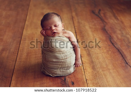 Adorable newborn baby boy - stock photo
