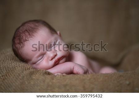 Adorable newborn baby boy - stock photo