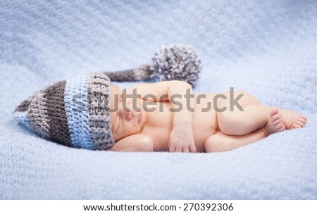 Adorable newborn baby boy sleeping - stock photo