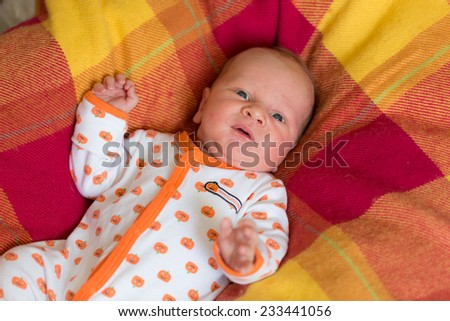 Adorable newborn baby crying alone - stock photo