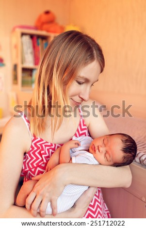 Adorable newborn baby in the arms of my mother  - stock photo