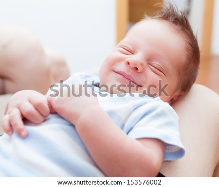 Adorable newborn baby peacefully sleeping - stock photo