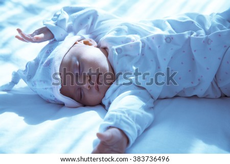 Adorable Newborn baby peacefully sleeping. Closeup Portrait. Toned in blue color. Studio shot, Horizontal - stock photo