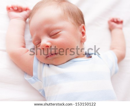 Adorable newborn baby sleeping - stock photo