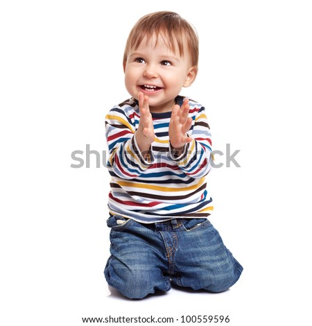 Adorable one year old child clapping and having fun, isolated on white - stock photo