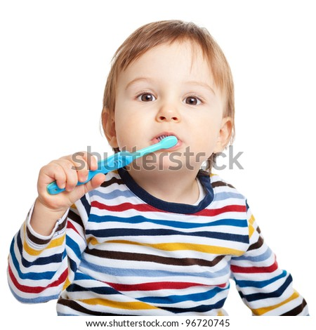 Adorable one year old child learning to brush teeth, isolated on white - stock photo