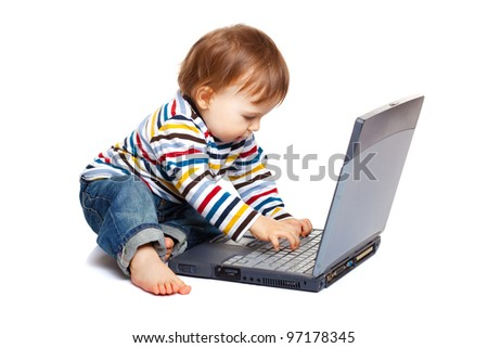 Adorable one year old child using laptop keyboard, isolated on white