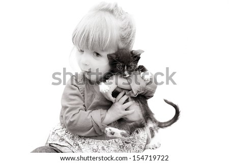 Adorable portrait of a baby holding her kitten.