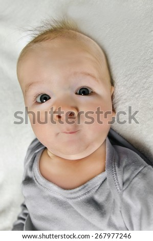 adorable portrait of a cute infant baby on white background - stock photo