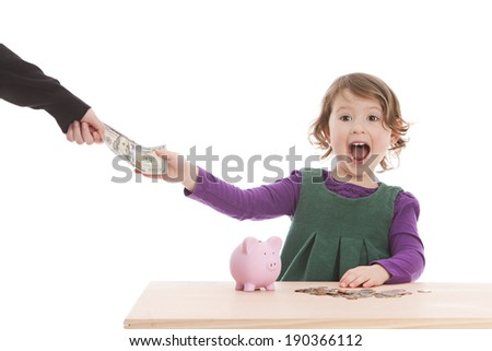 Adorable preschooler receiving a one hundred dollar bill in US currency.  Isolated on white with room for your text. - stock photo