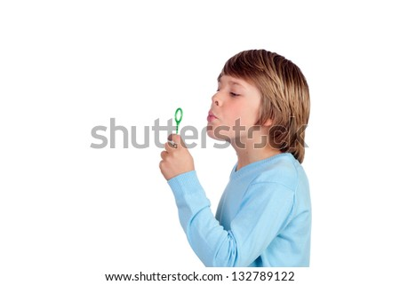 Adorable preteen boy blowing for make bubbles isolated on a over white background - stock photo