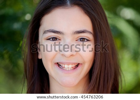 Adorable preteen girl with plants of background