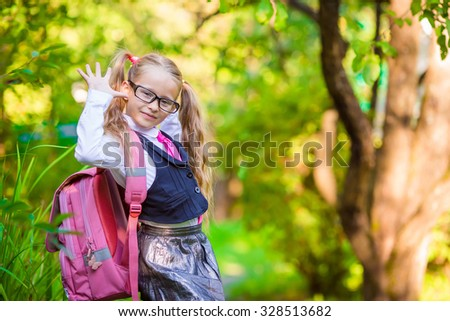Adorable school girl backpack notes outdoor. Back to school. - stock photo