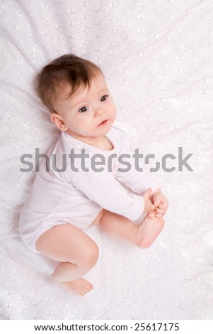 Adorable Seven month Baby girl wearing pink suite - stock photo