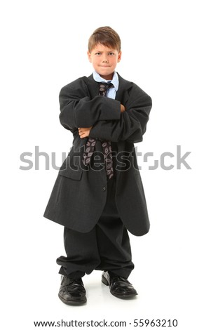 Adorable seven year old  american boy in over sized suit.