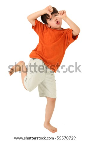 Adorable seven year old boy with tongue out and thumbs down over white background. - stock photo