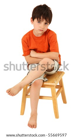 Adorable seven year old Caucasian boy with unhappy or bored expression. - stock photo