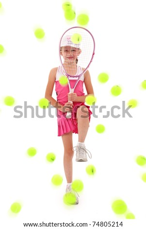 Adorable seven year old caucasian girl in tennis uniform defending herself with racquet being pelted by tennis balls over white. - stock photo
