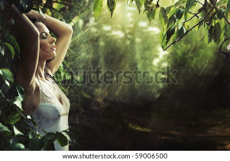 Adorable sexy brunette in a rain forest - stock photo