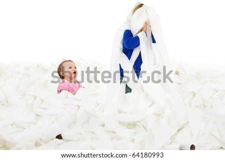 Adorable siblings playing in giant pile of toliet paper over white. - stock photo