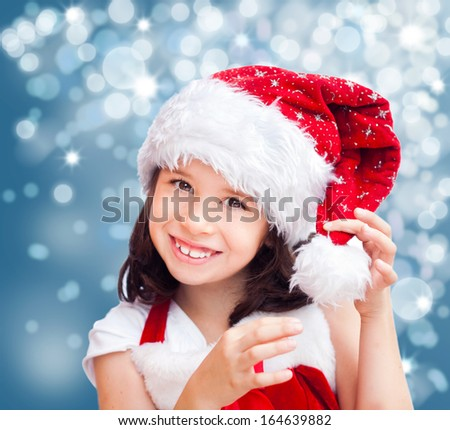 Adorable smiling girl wearing Christmas hat and clothes